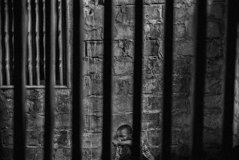 Abdoulaye, 15, imprisoned in one room of a daara in the Diamaguene area, city of Thies, Senegal, May 18, 2015. The rooms have windows with security bars to keep the talibes from running away.