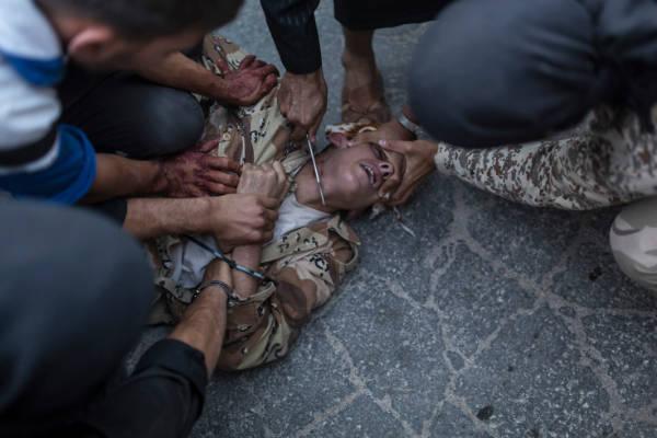 las-10-fotos-mas-impactantes-del-2013-ejecución-en-Siria