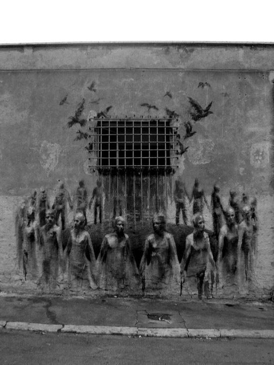 las-mejores-fotografias-de-arte-callejero-o-urbano-carcel-pajaros