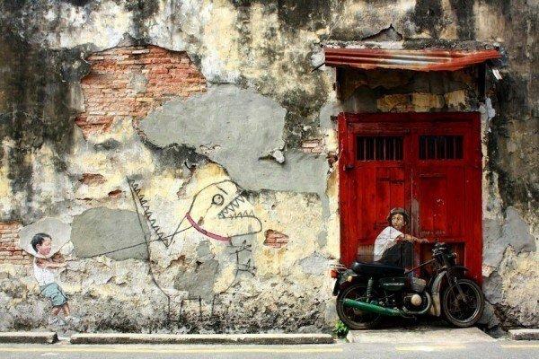 las-mejores-fotografias-de-arte-callejero-o-urbano-niño-monstruo-pared